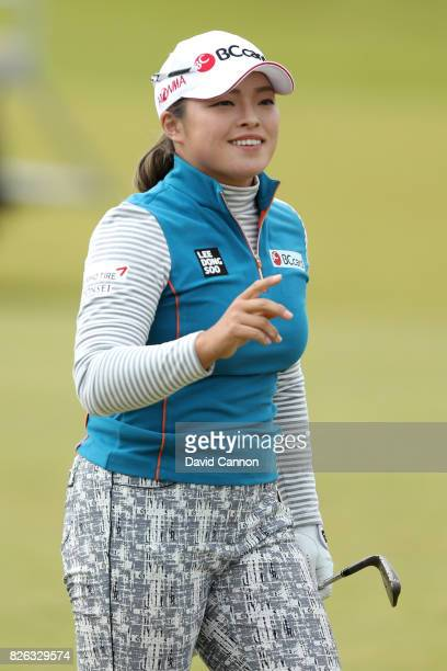 Ha Na Jang of Korea acknowledges the crowd on the 18th hole during the second round of the Ricoh Women's British Open at Kingsbarns Golf Links on...