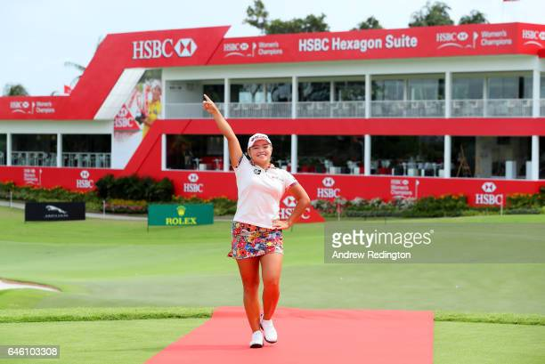 Ha Na Jang of Korea walk down a red carpet during a photocall for HSBC Women's Champions on the Tanjong Course at Sentosa Golf Club on February 28...