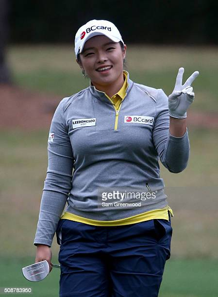 Ha Na Jang of South Korea displays the 'peace' sign as she walks down the 8th hole during the final round of the Coates Golf Championship Presented...