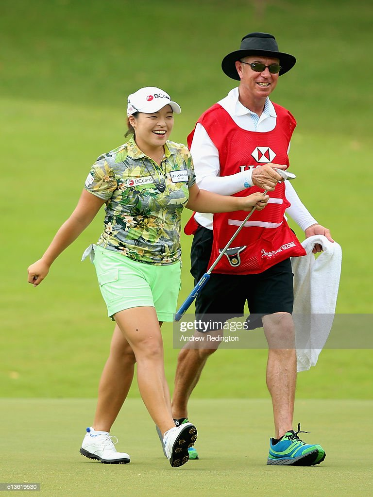 Ha Na Jang of South Korea smiles with her caddie after her par on the tenth hole during the second round of the HSBC Women's Champions at Sentosa Golf Club on March 4, 2016 in Singapore, Singapore.