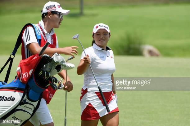 Ha Na Jang of South Korea walks with her caddie on the 16th hole during the final round of the HSBC Women's World Championship at Sentosa Golf Club...