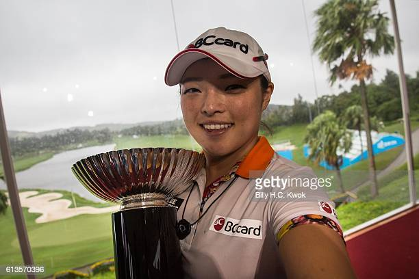 Ha Na Jang pretends to take a selfie while holding the trophy after winning the competition in the Fubon Taiwan LPGA Championship on October 9 2016...