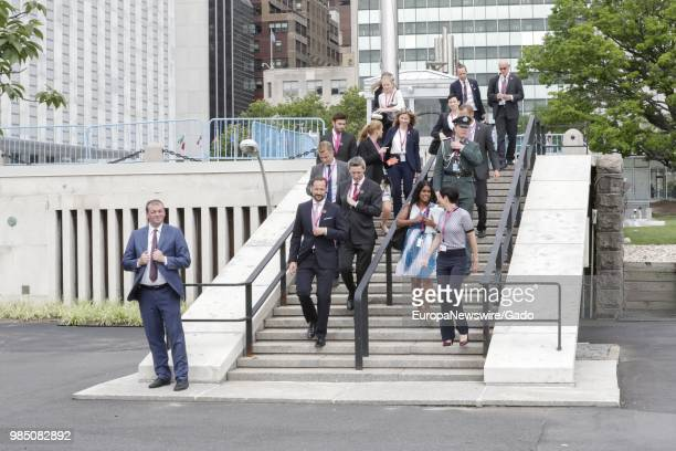 Haakon Crown Prince of Norway and Ine Eriksen Soreide Norwegian Minister of Foreign Affairs walking with a large group outside the United Nations in...