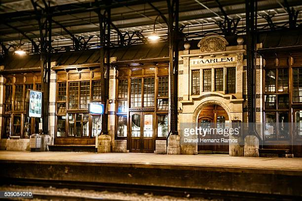 haarlem train station by night. the netherlands - station stock pictures, royalty-free photos & images