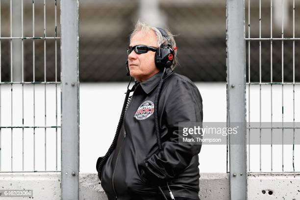 Haas F1 Founder and Chairman Gene Haas watches the action from the pit wall during day two of Formula One winter testing at Circuit de Catalunya on...