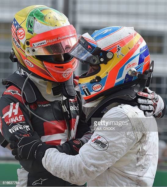 Haas F1 Team's Brazilian driver Esteban Gutierrez comforts McLaren Honda's Spanish driver Fernando Alonso after they crashed during the Formula One...