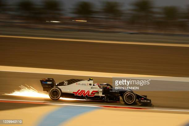 Haas F1's Danish driver Kevin Magnussen drives during the first practice session ahead of the Sakhir Formula One Grand Prix at the Bahrain...