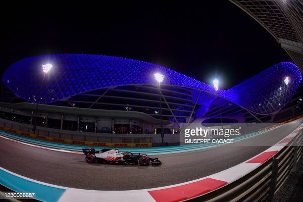Haas F1's Danish driver Kevin Magnussen drives during the second practice session ahead of the Abu Dhabi Formula One Grand Prix at the Yas Marina...