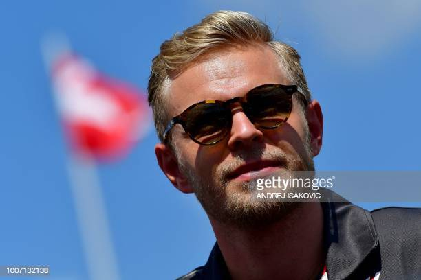 Haas F1's Danish driver Kevin Magnussen is pictured prior to the race of the Formula One Hungarian Grand Prix at the Hungaroring circuit in Mogyorod...