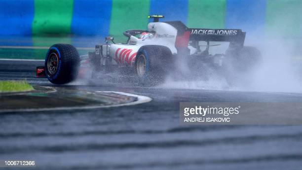 Haas F1's Danish driver Kevin Magnussen steers his car during the qualifying session on the eve of the Formula One Hungarian Grand Prix at the...