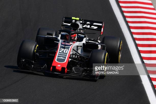 Haas F1's Danish driver Kevin Magnussen steers his car during the third free practice session ahead of the Formula One Hungarian Grand Prix at the...