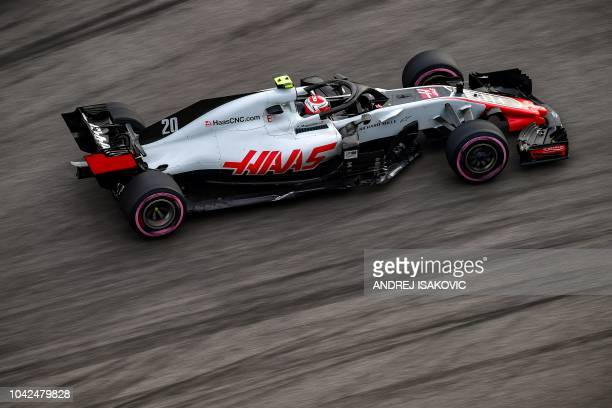Haas F1's Danish driver Kevin Magnussen steers his car during the second practice session of the Formula One Russian Grand Prix at the Sochi Autodrom...