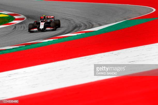 Haas F1's Danish driver Kevin Magnussen steers his car during the second practice session at the Austrian Formula One Grand Prix on July 3, 2020 in...
