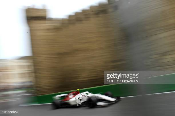 Haas F1's Danish driver Kevin Magnussen steers his car during the first practice session ahead of the Formula One Azerbaijan Grand Prix in Baku on...