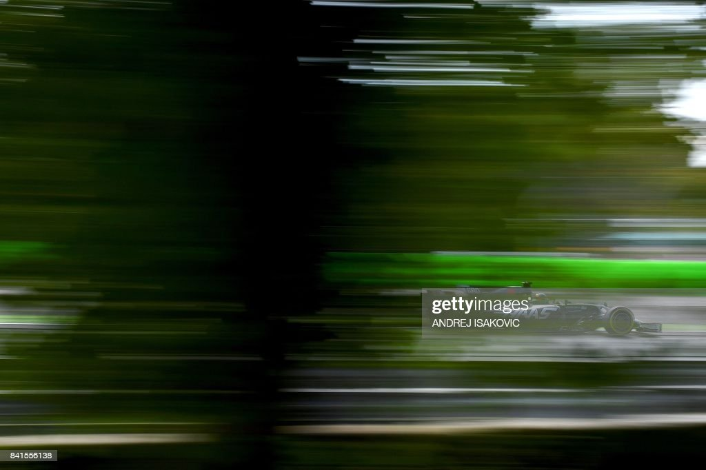 TOPSHOT - Haas F1's French driver Romain Grosjean drives during the second practice session at the Autodromo Nazionale circuit in Monza on September 1, 2017 ahead of the Italian Formula One Grand Prix. /