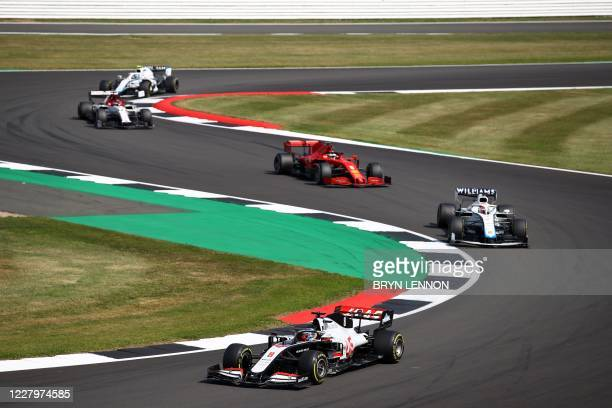 Haas F1's French driver Romain Grosjean drives through a corner during the F1 70th Anniversary Grand Prix at Silverstone on August 9, 2020 in...