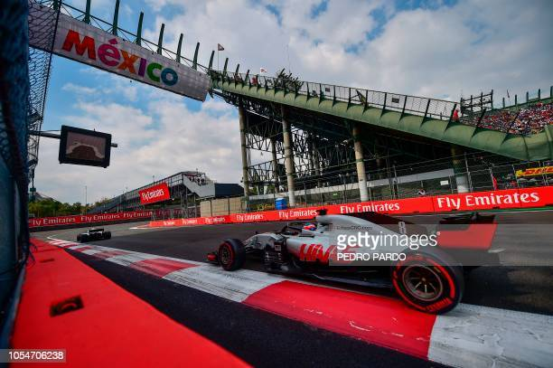 Haas F1's French driver Romain Grosjean powers his car during the F1 Mexico Grand Prix at the Hermanos Rodriguez circuit in Mexico City on October 28...