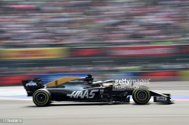 Haas F1's French driver Romain Grosjean powers his car during the F1 Mexico Grand Prix at the Hermanos Rodriguez racetrack in Mexico City on October...
