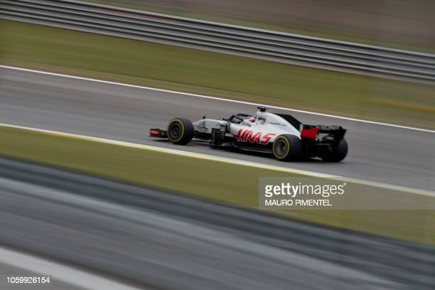 Haas F1's French driver Romain Grosjean powers his car during the free practice session of the F1 Brazil Grand Prix at the Interlagos racetrack in...