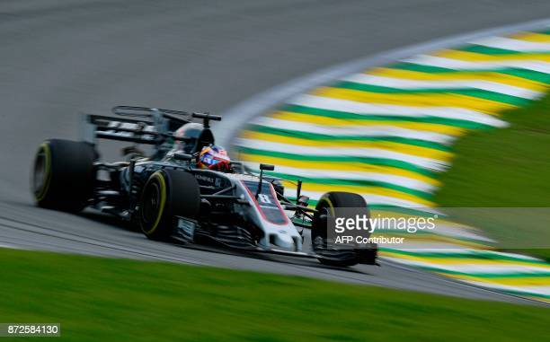 Haas F1's French driver Romain Grosjean powers his car during the Brazilian Formula One Grand Prix practice session, at the Interlagos circuit in Sao...