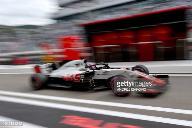 Haas F1's French driver Romain Grosjean steers his car during the first practice session of the Formula One Russian Grand Prix at the Sochi Autodrom...