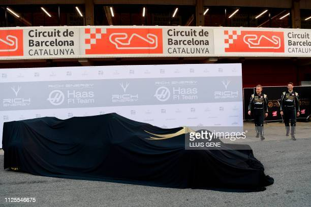 Haas French driver Romain Grosjean and Haas Danish driver Kevin Magnussen arrive to unveil the Haas VF19 formula one car at the Circuit de Catalunya...