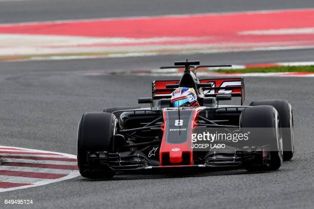 Haas' French driver Romain Grosjean drives at the Circuit de Barcelona Catalunya on March 8 2017 in Montmelo on the outskirts of Barcelona during the...