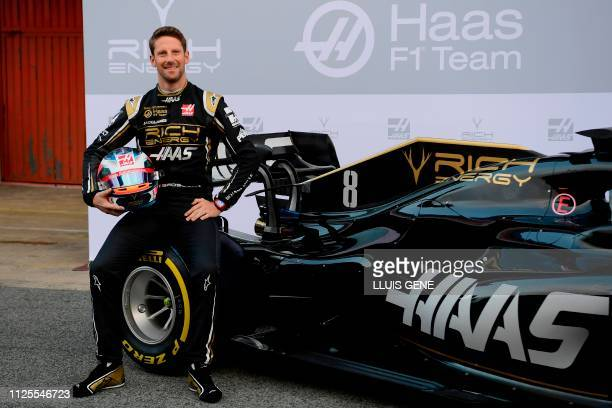 Haas French driver Romain Grosjean poses after unveiling the Haas VF-19 formula one car at the Circuit de Catalunya in Montmelo in the outskirts of...