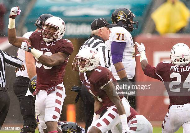 Haason Reddick and Tavon Young of the Temple Owls react after the Owls recovered a fumble in the first half against the East Carolina Pirates on...