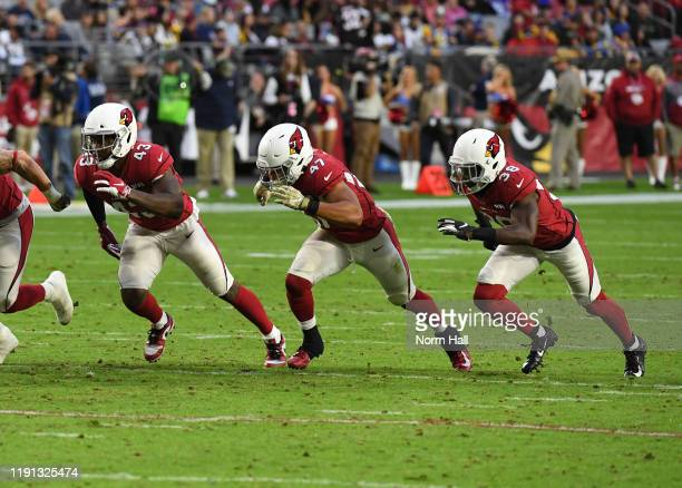 Haason Reddick Ezekiel Turner and Chris Banjo of the Arizona Cardinals attempt to block a punt against the Los Angeles Rams during the second half at...
