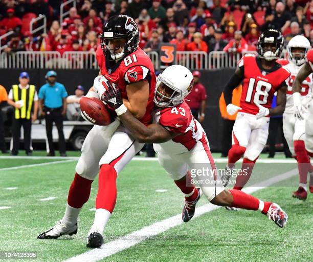 Haason Reddick of the Arizona Cardinals knocks the ball away at the goal line from Austin Hooper of the Atlanta Falcons at MercedesBenz Stadium on...