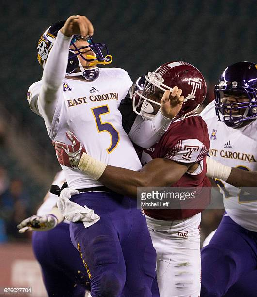 Haason Reddick of the Temple Owls hits Gardner Minshew of the East Carolina Pirates after throwing a pass in the fourth quarter at Lincoln Financial...