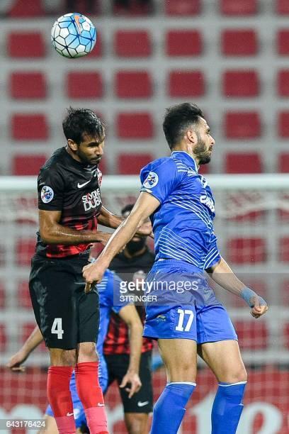 Habib alFardan of UAE's AlAhli FC fights for the ball against Ali Ghorbani of Iran's Esteghlal FC during their AFC Champions League qualifying...