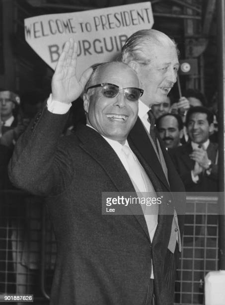 Habib Bourguiba the President of Tunisia is greeted by British Prime Minister Harold Macmillan upon his arrival at Victoria Station in London on an...