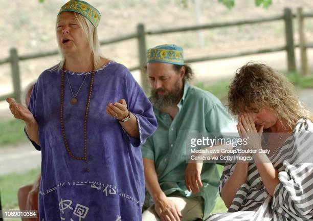 Habiba Kabir, left, says a prayer during a prayer service for rain at Walden Ponds Wildlife Sanctuary Sunday affternoon as Connie Burkhart, behind,...