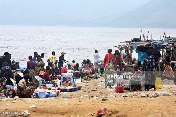 Habibou BANGRE People gather at a market on July 21, 2011 on the banks of the Congo river near the village of Ngamanzo in the municipality of Maluku,...