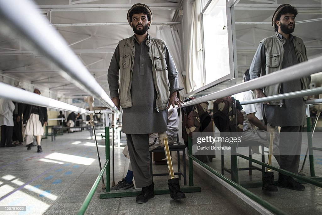 Habibullah, 24, a tailor from Wardak province, lost his leg when he drove over an IED a year ago, practices walking on his new artificial limb on his third day at the International Committee of the Red Cross (ICRC), orthopedic centre on November 20, 2012 in Kabul, Afghanistan. The ICRC rehabilitation centre works to educate and rehabilitate land-mine victims, and those with limb related deformities, back into society and employment offering micro-credit financing, home schooling and vocational training to patients. The clinic itself is unique in that all of the workers are handicapped. The ICRC centre in Kabul has registered over 57,000 patients and 114,000 countrywide in all of their centres since its inception 25 years ago.