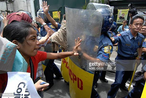 Hacienda Luisita farmers along with student activists scuffle with policemen during a rally near the house of presidential candidate and senator...