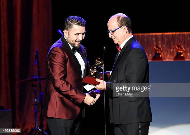 Haciendo Historia accepts the award for Best Banda Album onstage from composer Antonio Adolfo at the 15th annual Latin GRAMMY Awards premiere...