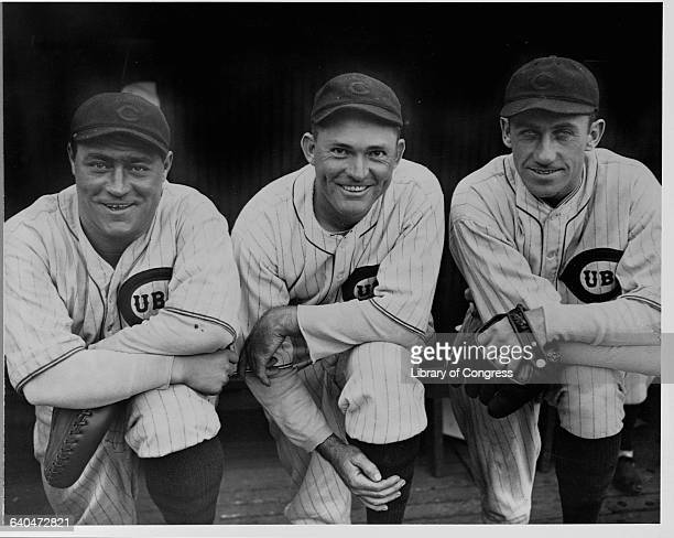 Hack Wilson Rogers Hornsby and Kiki Cuyler in full uniform in a dugout