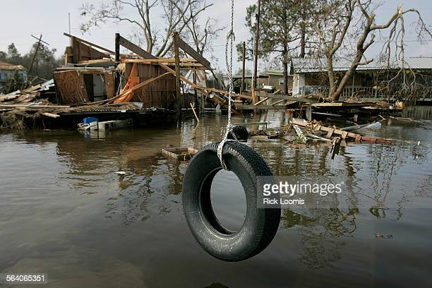 Hackberry La – A tire swing remains undisturbed amid the destruction left behind by Hurricane Rita which came through the area early Saturday morning