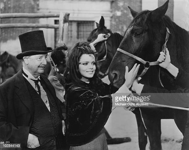 Hackenschmidt and Marie Hackenschmidt with the black stallion in a scene from the movie 'Black Beauty' which was released in 1971