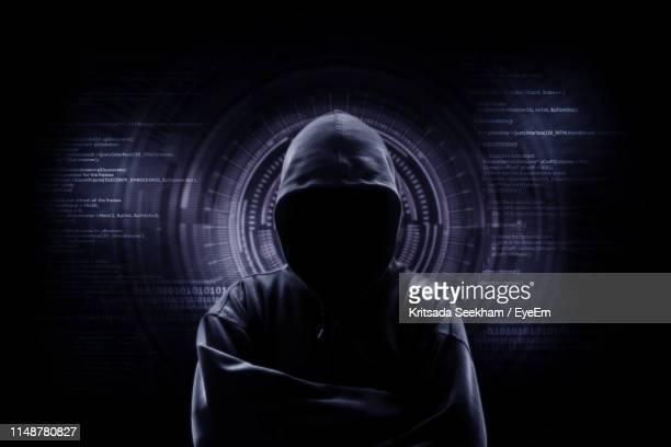 hacker against digital display - obscured face stock pictures, royalty-free photos & images