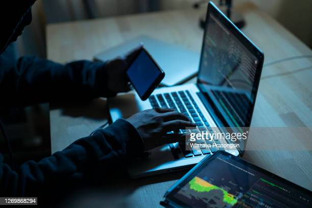 hacker attacking internet - conspiracy stock pictures, royalty-free photos & images