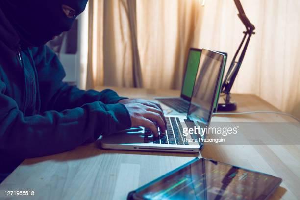 hacker attacking internet - crimineel stockfoto's en -beelden