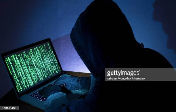 hacker attacking internet - hacker imagens e fotografias de stock