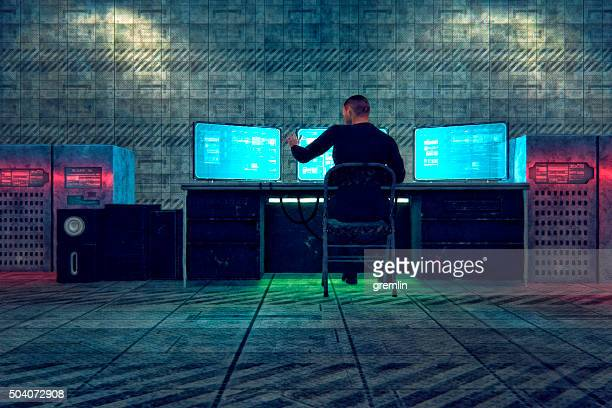 hacker in old warehouse - surveillance stock photos and pictures