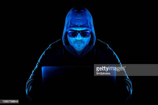 hacker man with laptop stealing personal data from internet - threats stock pictures, royalty-free photos & images