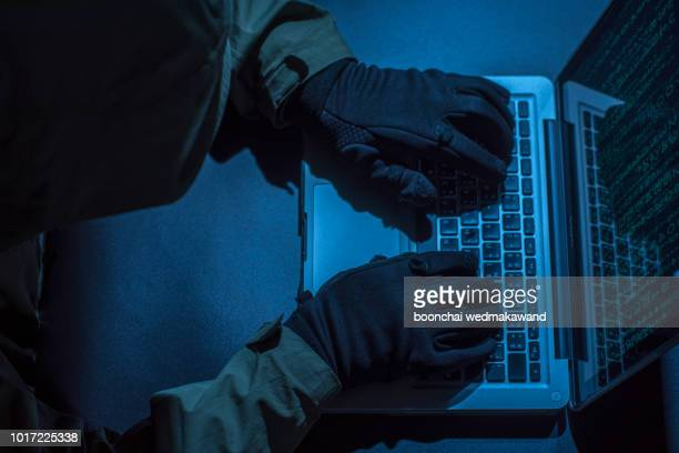 hacker stealing password and identity, computer crime - scammer stock pictures, royalty-free photos & images