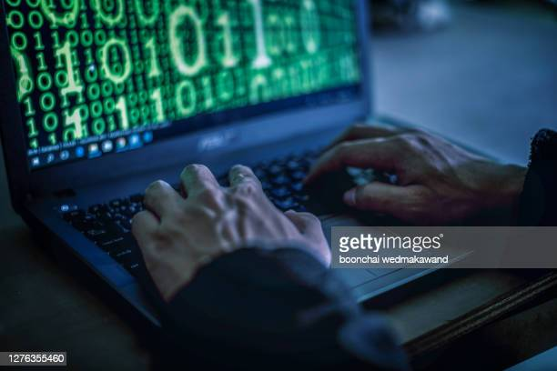 hacker stealing password and identity, computer crime. - fraud stock pictures, royalty-free photos & images
